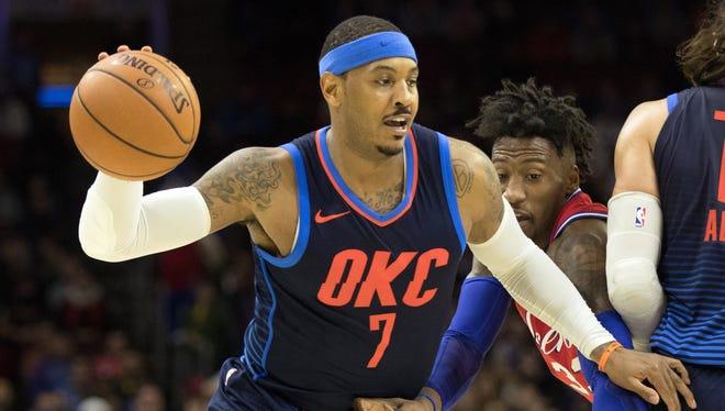 Oklahoma City Thunder forward Carmelo Anthony (7) dribbles past Philadelphia 76ers forward Robert Covington (33) during overtime at Wells Fargo Center on Friday, Dec. 15, 2017 in Philadelphia.