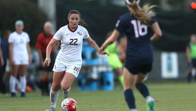 FSU's Kirsten Crowley tries to get past UConn's Regan Schiappa during their game earlier this season.