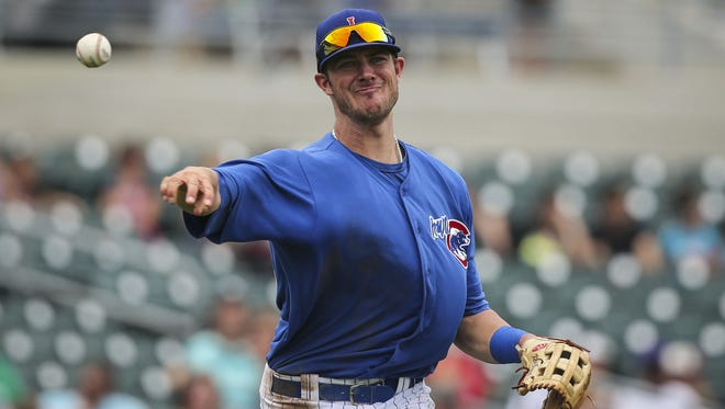 Iowa Cubs third baseman (19) Kris Bryant throws the ball to first for an out during the fourth inning versus the Albuquerque Isotopes Monday June 23, 2014, at Principal Park.