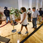 Members of the public file past the casket of blues legend B.B. King and his iconic guitar, Lucille, during a public viewing on Friday at the B.B. King Museum and Delta Interpretive Center in Indianola.  King will be buried at the museum on Saturday.