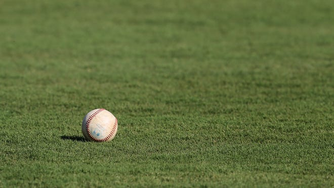 A baseball lies in the outfield at Trustmark Park in Pearl.