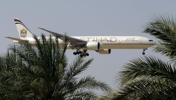 An Etihad Airways flight prepares to land at the Abu