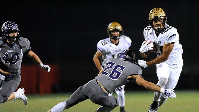 Abilene High running back Abram Smith (28) shoves away Keller Timber Creek safety Michael Saunders (26) during the first quarter of the Eagles' 56-31 win on Thursday, Nov. 3, 2016, at Keller Athletic Complex.