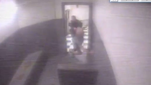 """Still image from jail surveillance video showing Mark Myers being pushed, according to a lawsuit, into a """"cinder block"""" structure in a cell at the Hamilton County Justice Center."""