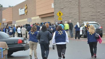Employees of the Walmart store in Pineville return to the building Friday after police checked the premises following a bomb threat. Employees and customers were evacuated during the police search.