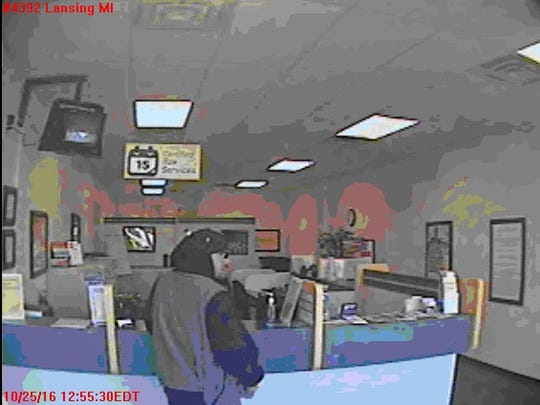 Police continue to investigate an armed robbery that happened in Lansing Township Tuesday.