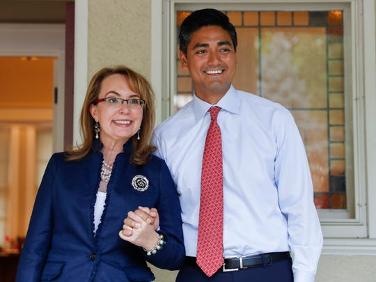 "Former U.S. Rep. Gabby Giffords, left, and Hamilton County Clerk of Courts Aftab Pureval stand for photographs during the ""Women for Aftab"" advocacy group kickoff event in support of Pureval's 1st House District challenge to veteran Republican Rep. Steve Chabot, Wednesday, June 13, 2018, in Cincinnati. Pureval pledges to support pay equity, protecting health care coverage, and paid family leave. (AP Photo/John Minchillo)"