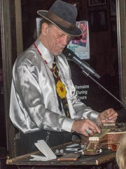 Blues musician Watermelon Slim plays slide guitar Sunday,