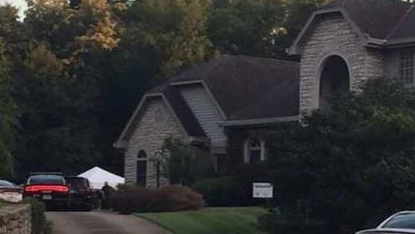 A 15-year-old girl was killed when a tree fell on her in the backyard of this Pebble Creek Drive home in Fort Thomas.