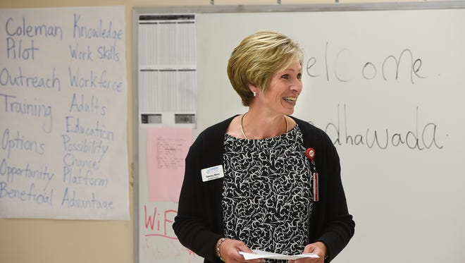 Career Solutions Executive Director Tammy Biery speaks during a celebration for students who recently completed an adult education program Wednesday, Aug. 16, at the Coleman Co. Inc. in Sauk Rapids.