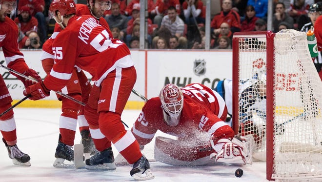 Winnipeg Jets right wing Drew Stafford (not pictured) scores a goal on Detroit Red Wings goalie Jimmy Howard during the second period.