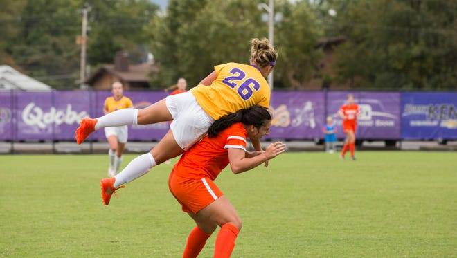Northern Iowa's Morgan Teel leaps over UE's Jess O'Shaughnessy to get the ball during Sunday afternoon's game.