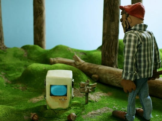 """A still from the film """"Log.txt,"""" by Ben Doran, about a lumberjack who stumbles upon a computer left alone for a reason.  The film is part of the 2017 Fast Forward Film Festival."""