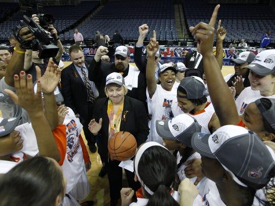 UTEP head coach Keitha Adams, center, and team members