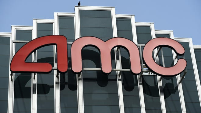 The AMC sign at the currently closed AMC Burbank 16 movie theatres complex is pictured, Wednesday, April 29, 2020, in Burbank, Calif.