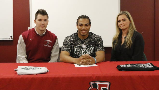Elmira's Allaah Sessions with Express head coach Jimmy McCauley and Sessions' mom, Reba Kingsbury, after Sessions signed a National Letter of Intent to play football at Wagner University during a ceremony Thursday at Elmira High School.