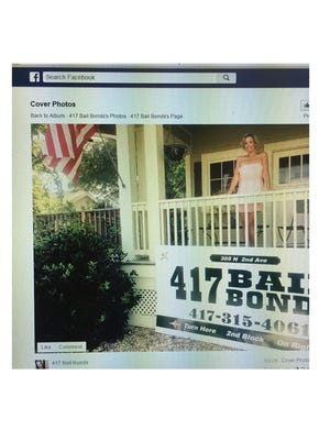 Somer Speer stands outside her business, 417 Bail Bonds, in a picture from the Facebook profile of 417 Bail Bonds.