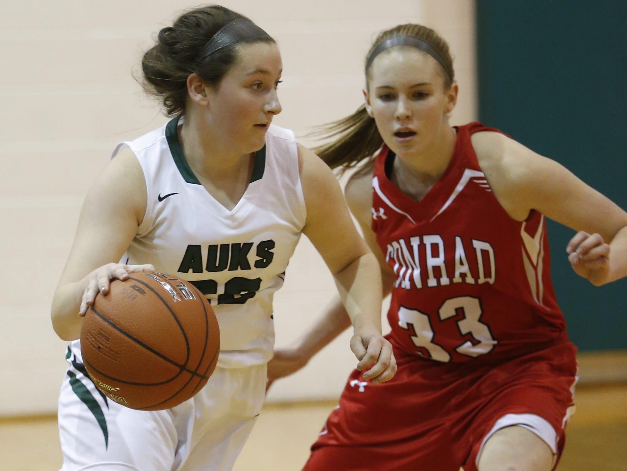 Archmere's Emma McCann (22), seen here against Conrad, led her team with nine points as the Auks defeated Wilmington Friends 34-26 in the first round of the DIAA girls basketball tournament on Tuesday.