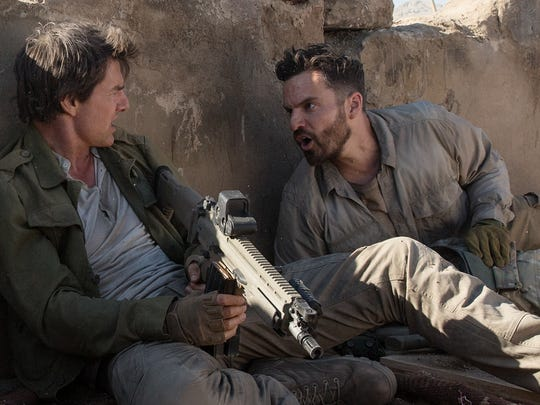 "Nick (Tom Cruise, left) and Chris (Jake Johnson) battle an evil force in ""The Mummy."""