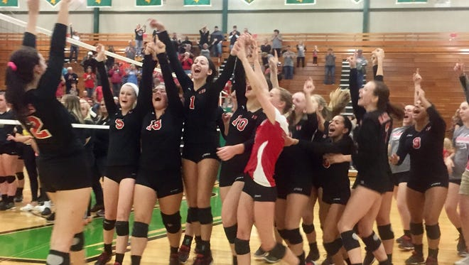 Wapahani celebrates its win  over Rochester on Saturday at the Bremen Semi-State.