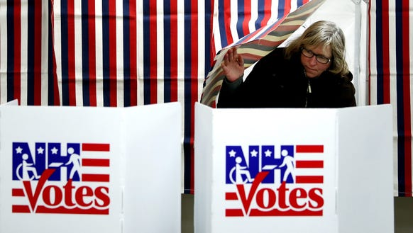 A voter exits a voting booth after casting a ballot