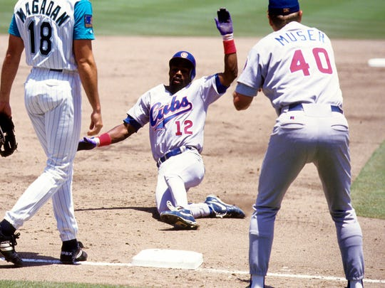 Chicago Cubs shortstop Shawon Dunston slides into to