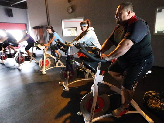 Tony Jacquez takes part in a spinning class at Rock Solid Fitness.