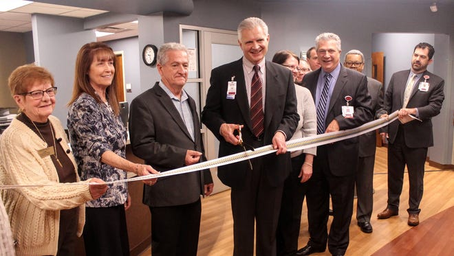 Officials from Schoolcraft College, the St. Joseph Mercy Health System and the City of Livonia cut the ribbon on the new St. Joe's Urgent Care clinic in the Jeffress Center at Seven Mile and Haggerty in Livonia.