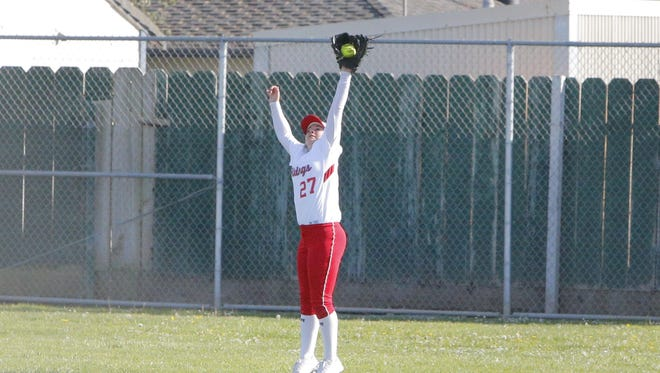 North Salinas High's Alissa Foster reaches up to catch a flyball during Wednesday's game against Stevenson.