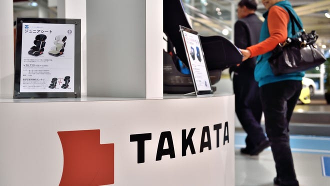 Japanese auto parts maker Takata Corp's auto accessories on display at a car showroom in Tokyo. The second-highest ranking official at the National Highway Traffic Safety Administration is defending the agency's decision not to seek a nationwide recall for some passenger-side air bags produced by the company.