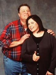 John Goodman, left, and Roseanne Barr, seen here in