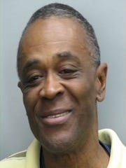 Norris Farlow, 54, has been arrested for a Tuesday carjacking.