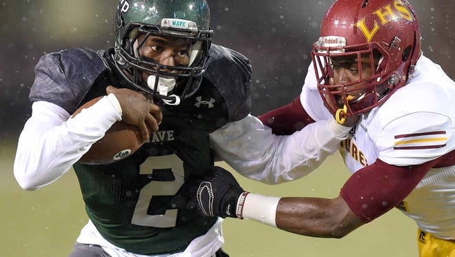 West Point's Marcus Murphy (2) fend off a Laurel defender with a stiff arm in the Class 5A championship at Davis Wade Stadium in Starkville.