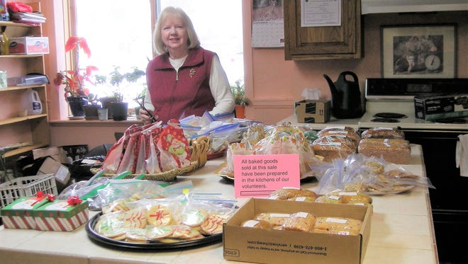 Linda Oxshear will help customers with their baked goods selection at the Capitan Library holiday bazaar Dec. 2.