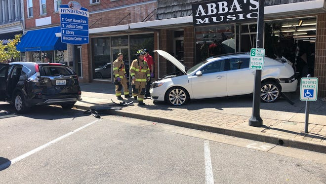 HPD said a vehicle struck the front of Abba's Music Monday afternoon. No one was injured.