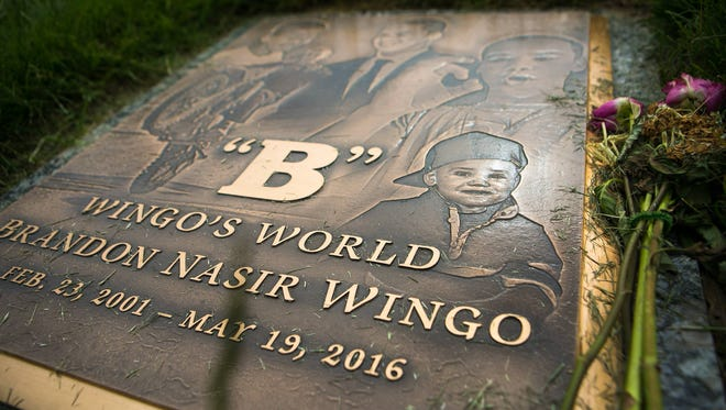 The grave stone of Brandon Wingo rests at Gracelawn Cemetery in an area called Garden of Serenity just 80 steps away from the grave of Jordan Ellerbe, a teen believed to be associated with a rival gang in Wilmington.