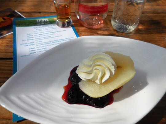 A cider poached pear with a Mystery Bay goat cheese mousse sitting on Finnriver blueberry compote was dessert for a day of eating and tasting at Finnriver in Chimacum.