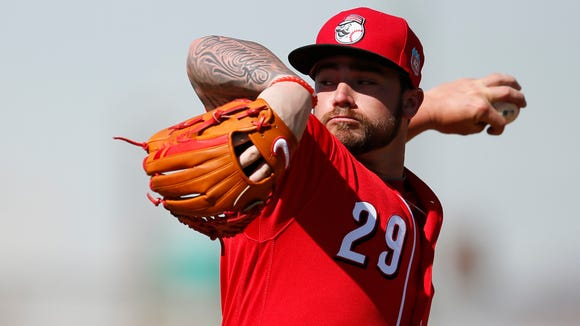 Cincinnati Reds pitcher Brandon Finnegan (29) throws during live batting practice at Cincinnati Reds spring training, Thursday, Feb. 25, 2016, in Goodyear, Arizona.