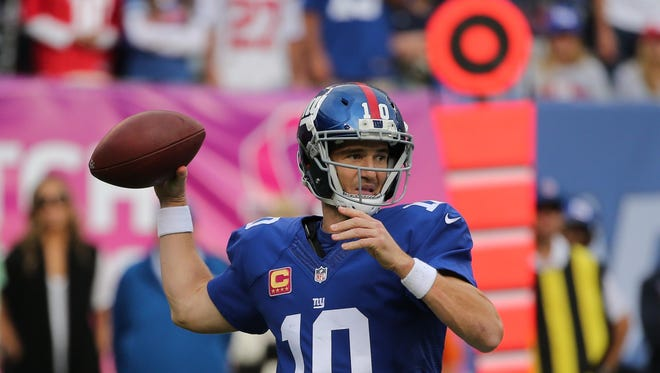 Giants quarterback Eli Manning throws a pass during the second half of Sunday's home game against the Baltimore Ravens.