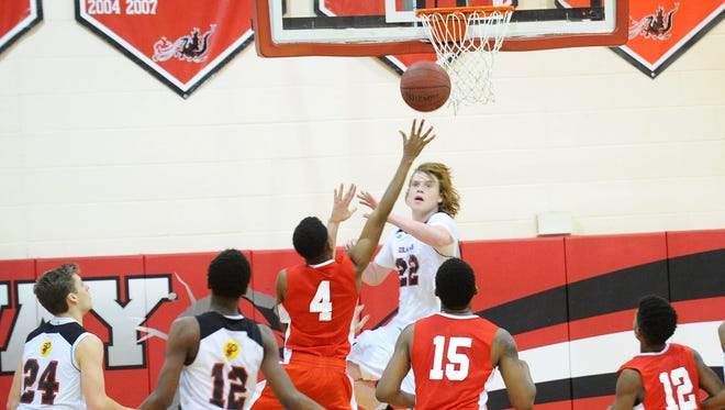 Delsea's Nate Cox (4) hits the game-winning shot at the buzzer to give the Crusaders a thrilling 63-62 victory over Kingsway on Thursday.