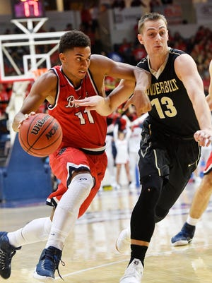 Riley LaChance (13) stays with Kevin McClain as he goes for the basket as Vanderbilt plays Belmont at Belmont's Curb Event CenterMonday Nov. 13, 2017, in Nashville, TN