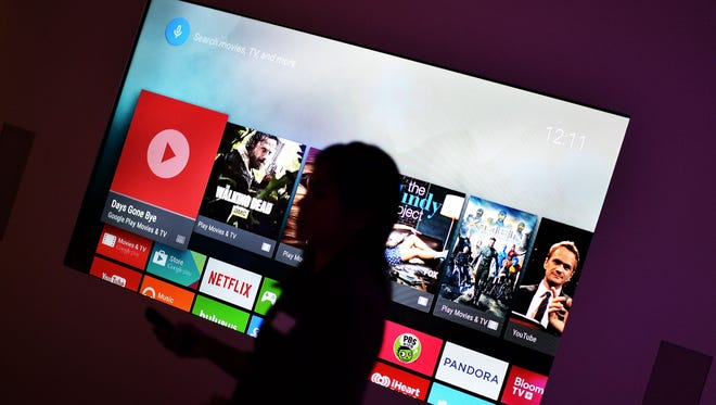 A Google employee exhibits the functionalities of an Android TV device in New York on Oct. 29, 2014. A new study by Nielsen says Millennials lead other age groups in media consumption on smartphones but watch the least amount of live television.