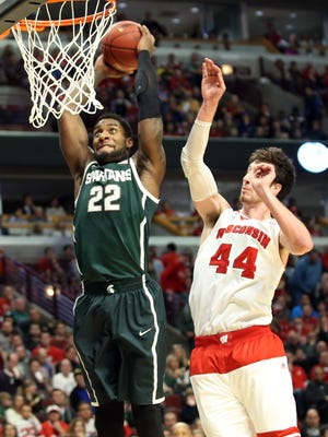 Michigan State's Branden Dawson dunks in front of Wisconsin's Frank Kaminsky during the Big Ten tournament championship game on March 15.