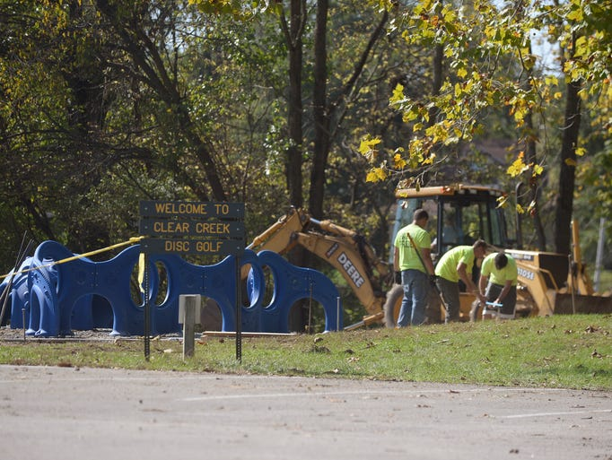 Crews work Friday on the Playground with a Purpose