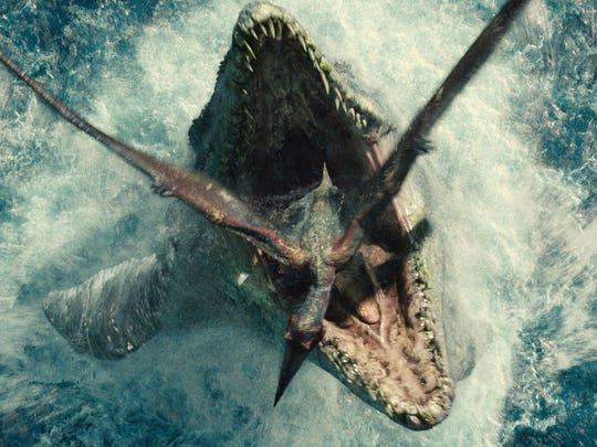 A Mosasaurus emerges from the water to chomp on its prey in 'Jurassic World.'