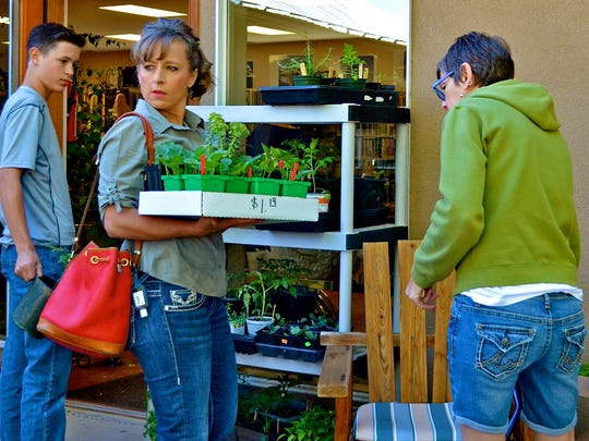Shoppers started early to get the best pickings of indoor/outdoor plants, vegetables, shrubs and more.