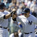 The Yankees' Carlos Beltran, left, and Brian McCann celebrate after McCann hit a two-run home run during the sixth inning of Saturday's game against the Boston Red Sox.