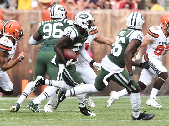 Oct 8, 2017; Cleveland, OH, USA; New York Jets cornerback Morris Claiborne (21) returns an interception during the second half against the Cleveland Browns at FirstEnergy Stadium. Mandatory Credit: Ken Blaze-USA TODAY Sports