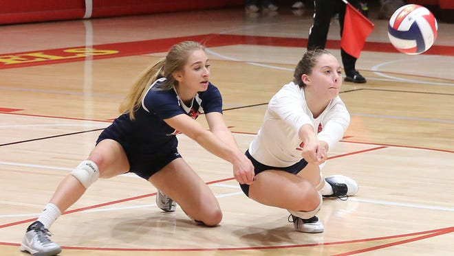 Brookfield East's Makenna Berry (right), goes low to make a shot as Ella Mortensen backs her up.