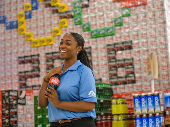 Domonique Williams is known as the Singing Cashier